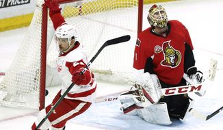 Detroit Red Wings' Tomas Tatar (21) celebrates his goal as Ottawa Senators goaltender Mike Condon (1) looks on during the second period of an NHL hockey game in Ottawa, Ontario, Thursday Dec. 29, 2016.  (Fred Chartrand/The Canadian Press via AP)
