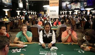FILE - In this July 5, 2014, file photo, players compete on the first day of the World Series of Poker main event in Las Vegas. A power outage has forced the evacuation of 900 rooms at the Rio casino in Las Vegas, officials said. Spokesman Richard Broome of the Rio's parent company, Caesars Entertainment, said he hoped the tower would be fully reopened by New Year's Eve. (AP Photo/John Locher, File)