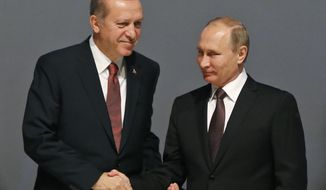 FILE - In this Oct. 10, 2016 file photo, Turkey's President Recep Tayyip Erdogan, left and Russian President Vladimir Putin, shake hands following the group photo at the World Energy Congress, in Istanbul, Turkey. (AP Photo/Emrah Gurel, File)