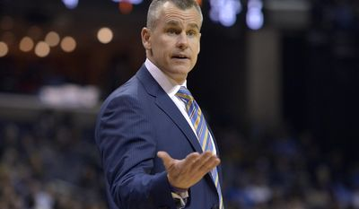 Oklahoma City Thunder head coach Billy Donovan talks to a referee in the first half of an NBA basketball game against the Memphis Grizzlies Thursday, Dec. 29, 2016, in Memphis, Tenn. (AP Photo/Brandon Dill)