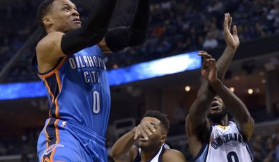 Oklahoma City Thunder guard Russell Westbrook (0) shoots against Memphis Grizzlies guard Andrew Harrison (5) and Memphis Grizzlies forward JaMychal Green (0) in the first half of an NBA basketball game Thursday, Dec. 29, 2016, in Memphis, Tenn. (AP Photo/Brandon Dill)