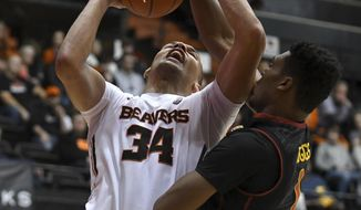Oregon State forward Ben Kone (34) is blocked by Southern California forward Charles Buggs during the first half of an NCAA college basketball game Wednesday, Dec. 28, 2016, in Corvallis, Ore. (Anibal Ortiz/The Corvallis Gazette-Times via AP)