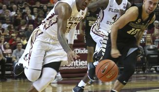 Florida State's Xavier Rathan-Mayes makes a steal against Wake Forest's Mitchell Willbekin and heads for a breakaway score during the second half of an NCAA college basketball game, Wednesday, Dec. 28, 2016, in Tallahassee, Fla. Florida State won 88-72. (AP Photo/Steve Cannon)