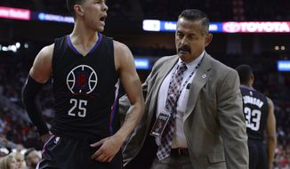Los Angles Clippers guard Austin Rivers (25) is escorted off the court after being ejected during the first half of the team's NBA basketball game against the Houston Rockets on Friday, Dec. 30, 2016, in Houston. (AP Photo/George Bridges)