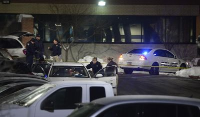 Police investigate a fatal shooting which took place in a parking lot near the University of Utah in Salt Lake City, Thursday, Dec. 29, 2016. University of Utah police say a man and woman have been fatally shot in a parking lot and authorities suspect it's a case of murder-suicide. The reports say the violence occurred outside of a laboratory at the University of Utah Research Park. (Scott Sommerdorf/The Salt Lake Tribune via AP)