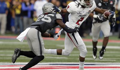 South Alabama wide receiver Tyrone Williams (2) stiff-arms Air Force defensive back Roland Ladipo during the first half of the Arizona Bowl NCAA college football game, Friday, Dec. 30, 2016, in Tucson, Ariz. (AP Photo/Rick Scuteri)