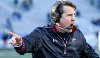 South Carolina head coach Will Muschamp reacts to a play during the second half of the Birmingham Bowl NCAA college football game against South Florida, Thursday, Dec. 29, 2016, in Birmingham, Ala. (AP Photo/Butch Dill)