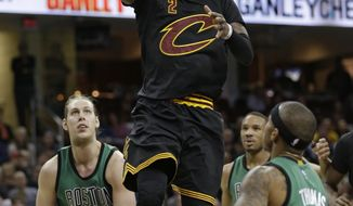 Cleveland Cavaliers' Kyrie Irving (2) drives to the basket against Boston Celtics' Isaiah Thomas (4) and Kelly Olynyk (41) in the second half of an NBA basketball game, Thursday, Dec. 29, 2016, in Cleveland. (AP Photo/Tony Dejak)