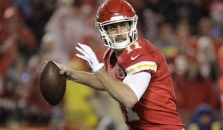 FILE -  In this Sunday, Dec. 25, 2016 file photo, Kansas City Chiefs quarterback Alex Smith (11) throws during the first half of an NFL football game against the Denver Broncos in Kansas City, Mo. What totally different experiences the Kansas City Chiefs and San Diego Chargers could have Sunday afternoon,  Jan. 1, 2017 at Qualcomm Stadium. Already in the playoffs for the third time in four years, Alex Smith and the Chiefs (11-4) need to beat the Chargers (5-10) and have the Denver Broncos beat the Oakland Raiders in order to clinch the AFC West title and a first-round bye. (AP Photo/Charlie Riedel, File)