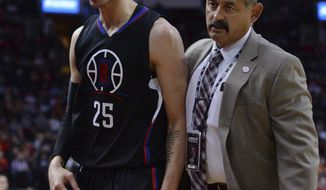 Los Angles Clippers guard Austin Rivers (25) is escorted off the court after being ejected during the firt half of the team's NBA basketball game against the Houston Rockets on Friday, Dec. 30, 2016, in Houston. (AP Photo/George Bridges)