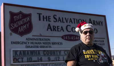 "ADVANCE FOR SATURDAY, DEC. 31, 2016 - In this undated photo Jim ""Dagger"" Dagostine, a biker who organizes a toy drive every year to deliver to the Salvation Army, stands outside of the Salvation Army in Charleston, W.Va.  (Sam Owens/Charleston Gazette-Mail via AP)"