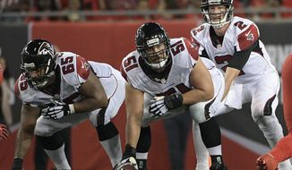 FILE - In this Nov. 3, 2016, file photo, Atlanta Falcons center Alex Mack (51) gets set to snap the ball to quarterback Matt Ryan (2)  during the second quarter of an NFL football game against the Tampa Bay Buccaneers in Tampa, Fla. The Falcons are delighted with their decision to make Mack the NFL's highest-paid center. (AP Photo/Phelan Ebenhack, File)