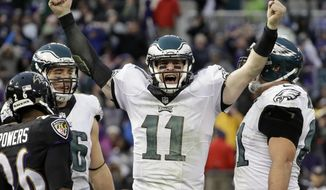 In a Sunday, Dec. 18, 2016 file photo, Philadelphia Eagles quarterback Carson Wentz (11) celebrates his touchdown during the second half of an NFL football game against the Baltimore Ravens in Baltimore. (AP Photo/Patrick Semansky, File)
