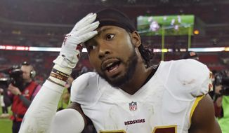 Washington Redskins cornerback Josh Norman (24) leaves the field after an NFL Football game against Cincinnati Bengals that ended in a 27-27 tie at Wembley Stadium in London, in this Sunday, Oct. 30, 2016, file photo. (AP Photo/Matt Dunham, File)