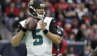 FILE - In a Sunday, Dec. 18, 2016 file photo, Jacksonville Jaguars quarterback Blake Bortles (5) looks to pass against the Houston Texans during the first half of an NFL football game in Houston. A maturing Bortles and a young, improving defense was supposed to put the Jacksonville Jaguars back in the AFC South title chase. That didnt happen, so now the Jaguars will use the Jan. 1 season finale to establish draft position and maybe find a few answers before embarking on another uncertain offseason. (AP Photo/Eric Christian Smith, File)