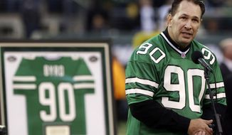 FILE - In this Oct. 28, 2012, file photo, former New York Jets player Dennis Byrd speaks during a halftime ceremony to retire his number during an NFL football game between the Jets and the Miami Dolphins in East Rutherford, N.J. The Nes have honored the late Dennis Byrd by voting to posthumously select the former defensive lineman as the winner of the team's award named after him. The Dennis Byrd Most Inspirational Award has been presented each year since 1992, with Byrd the first winner, to the most inspirational Jets player by a vote of his teammates. (AP Photo/John Minchillo, File)
