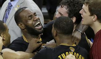 FILE - In this June 19, 2016, file photo, Cleveland Cavaliers forward LeBron James, left, celebrates with teammates after Game 7 of basketball's NBA Finals against the Golden State Warriors in Oakland, Calif. There was no stopping James this year. He continued to mesmerize on the court, his game showing no signs of decay now one-third of the way through his 14th season. (AP Photo/Eric Risberg, File)