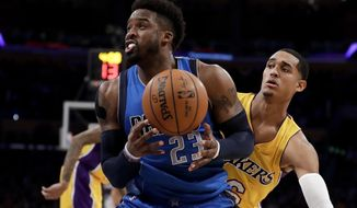Dallas Mavericks guard Wesley Matthews drives to the basket past Los Angeles Lakers guard Jordan Clarkson during the first half of an NBA basketball game in Los Angeles, Thursday, Dec. 29, 2016. (AP Photo/Chris Carlson)