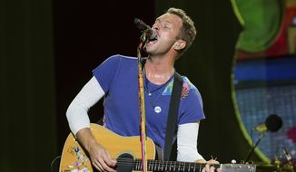 """FILE - In this Sept. 4, 2016, file photo, Chris Martin of Coldplay performs at The Budweiser Made In America Festival in Philadelphia. Martin covered George Michael's """"Last Christmas"""" at a homeless shelter in London. Video of the performance was posted to Facebook on Thursday, Dec. 29, 2016.(Photo by Michael Zorn/Invision/AP, File)"""