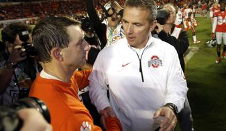 FILE - In this Jan. 4, 2014, file photo, Ohio State head coach Urban Meyer, right, shakes hands with Clemson head coach Dabo Swinney after the Orange Bowl NCAA college football game, Saturday, Jan. 4, 2014, in Miami Gardens, Fla. Clemson defeated Ohio State 40-35. Since taking over at Ohio State Urban Meyer has lost five times in 66 games, including once in a bowl game. Clemson and coach Dabo Swinney handed Meyer that bowl loss.  (AP Photo/Wilfredo Lee, File)