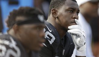 FILE - In this Sept. 13, 2015, file photo, Oakland Raiders linebacker Aldon Smith (99) sits on the bench during the second half of an NFL football game against the Cincinnati Bengals in Oakland, Calif. Suspended Oakland Raiders pass rusher Aldon Smith will not be reinstated by the NFL this season. NFL spokesman Brian McCarthy said Friday, Dec. 30, 2016,  that the league has deferred a decision on Smith's petition for reinstatement and will begin consideration in March. (AP Photo/Ben Margot, File)