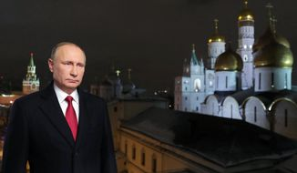 In this photo released by the Kremlin Press service via Sputnik agency, Saturday, Dec. 31, 2016, Russian President Vladimir Putin speaks during an undated recording of his annual televised New Year's message in the Kremlin in Moscow, Russia. (Mikhail Klimentyev/Kremlin Press Service, Sputnik, via AP)