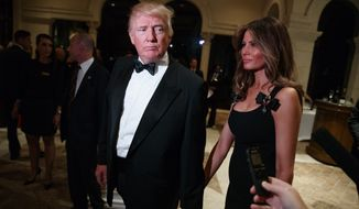 President-elect Donald Trump, left, and his wife Melania Trump arrives for a New Year's Eve party at Mar-a-Lago, Saturday, Dec. 31, 2016, in Palm Beach, Fla. (AP Photo/Evan Vucci)