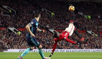 Manchester United's Paul Pogba, right, performs a scissor kick during their English Premier League soccer match against Middlesborough at Old Trafford, Manchester, England, Saturday, Dec. 31, 2016. (Martin Rickett/PA via AP)