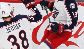 Columbus Blue Jackets right wing Cam Atkinson (13) celebrates his goal with teammate Boone Jenner (38) against the Minnesota Wild during the first period of an NHL hockey game Saturday, Dec. 31, 2016, in St. Paul, Minn.(AP Photo/Andy Clayton-King)