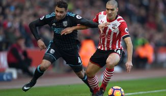 West Bromwich Albion's Hal Robson-Kanu, left, and Southampton's Oriol Romeu battle for the ball during their English Premier League soccer match at St Mary's Stadium, Southampton, England, Saturday, Dec. 31, 2016. (Daniel Hambury/PA via AP)