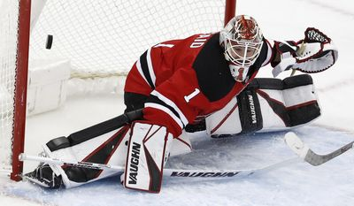 A shot by Washington Capitals left wing Marcus Johansson, not pictured, of Sweden, gets by New Jersey Devils goalie Keith Kinkaid (1) for a goal during the third period of an NHL hockey game, Saturday, Dec. 31, 2016, in Newark, N.J. (AP Photo/Julio Cortez)