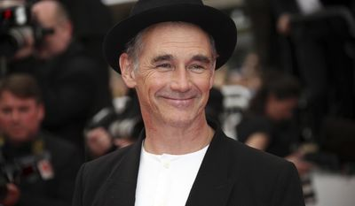 FILE - In this file photo dated  Saturday, May 14, 2016, actor Mark Rylance poses for photographers at the screening of the film The BFG, at the 69th international film festival, Cannes, southern France. During the Queen's 2017 New Year Honors list Rylance, 56, receives a knighthood, recognised for his services to theatre. (AP Photo/Joel Ryan, FILE)