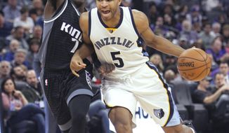 Memphis Grizzlies guard Andrew Harrison (5) drives around Sacramento Kings defender Darren Collison (7) during the first half of an NBA basketball game in Sacramento, Calif., Saturday, Dec. 31, 2016. (AP Photo/Steve Yeater)