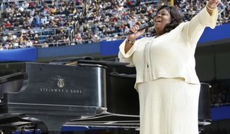 """FILE - In this Sunday, April 20, 2008 file photo, Kim Burrell performs prior to a Mass by Pope Benedict XVI at Yankee Stadium in New York. Ahead of a performance on the talk show """"Ellen"""" in early January 2017, gospel singer Burrell says she make """"no excuses or apologies"""" for a sermon at a Houston church where she referred to gays and lesbians as perverted. (AP Photo/Mike Segar, Pool)"""