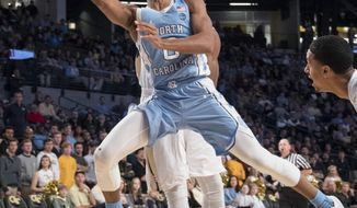 North Carolina guard Nate Britt goes to the basket as Georgia Tech guard Josh Okogie (5) defends from behind during the first half of an NCAA college basketball game, Saturday, Dec 31, 2016, in Atlanta. (AP Photo/John Amis)