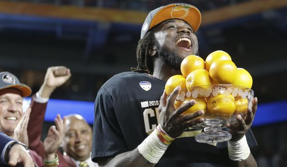 Florida State running back Dalvin Cook (4) holds the Orange Bowl MVP trophy after winning the Orange Bowl NCAA college football game, Saturday, Dec. 31, 2016, in Miami Gardens, Fla. Florida State defeated Michigan 33-32. (AP Photo/Alan Diaz)
