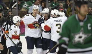 Florida Panthers center Jonathan Marchessault (81), center Nick Bjugstad (27), right wing Jaromir Jagr and defenseman Keith Yandle celebrate Jagr's goal against the Dallas Stars during the first period of an NHL hockey game in Dallas, Saturday, Dec. 31, 2016. (AP Photo/Michael Ainsworth)
