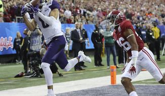 Washington wide receiver Dante Pettis gets past Alabama defensive back Marlon Humphrey for a touchdown reception  during the first quarter of the Peach Bowl NCAA college football playoff game, Saturday, Dec. 31, 2016, in Atlanta. (Curtis Compton/Atlanta Journal-Constitution via AP)