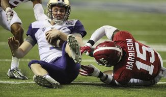 Alabama defensive back Ronnie Harrison tackles Washington quarterback Jake Browning on a quarterback keeper during the second quarter quarter of the Peach Bowl NCAA college football playoff game, Saturday, Dec. 31, 2016, in Atlanta. (Curtis Compton/Atlanta Journal-Constitution via AP)
