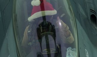A fighter pilot wearing a Santa hat is shown in this Defense Dept. photo, via Business Insider [http://www.businessinsider.com/us-air-force-pilots-santa-hats-isis-airstrikes-iraq-2016-12].
