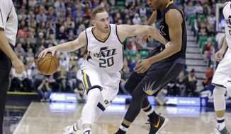 Phoenix Suns forward TJ Warren, right, guards Utah Jazz forward Gordon Hayward (20) in the first half during an NBA basketball game Saturday, Dec. 31, 2016, in Salt Lake City. (AP Photo/Rick Bowmer)