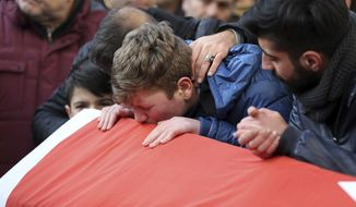 Funeral services were held for victims of what Turkish authorities are calling a terrorist attack. A gunman shot his way into an Istanbul nightclub packed with New Year's revelers and killed 39 people before fleeing the scene. (Associated Press)