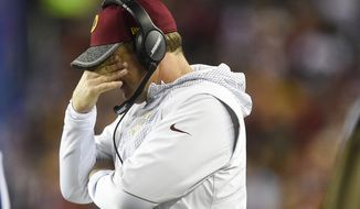 Washington Redskins head coach Jay Gruden rubs his eyes during the first half of an NFL football game against the New York Giants in Landover, Md., Sunday, Jan. 1, 2017. (AP Photo/Nick Wass)