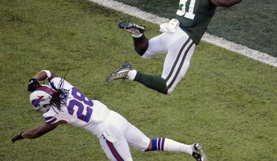 New York Jets wide receiver Quincy Enunwa (81) leaps over Buffalo Bills cornerback Ronald Darby (28) for a first down gain during the first half of an NFL football game, Sunday, Jan. 1, 2017, in East Rutherford, N.J. (AP Photo/Peter Morgan)