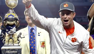 Clemson coach Dabo Swinney celebrates after the team's Fiesta Bowl NCAA college football playoff semifianl against Ohio State, Saturday, Dec. 31, 2016, in Glendale, Ariz. Clemson won 31-0 to advance to the BCS championship game Jan. 9 against Alabama. (AP Photo/Ross D. Franklin)