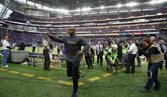 Injured Minnesota Vikings running back Adrian Peterson runs off the field after an NFL football game against the Chicago Bears, Sunday, Jan. 1, 2017, in Minneapolis. (AP Photo/Andy Clayton-King)