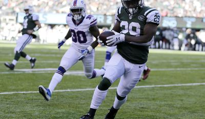 New York Jets running back Bilal Powell (29) scores on a touchdown pass from quarterback Ryan Fitzpatrick, far left, as Buffalo Bills cornerback Corey White (30) pursues during the first half of an NFL football game, Sunday, Jan. 1, 2017, in East Rutherford, N.J. (AP Photo/Seth Wenig)