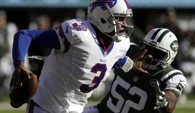 Buffalo Bills quarterback EJ Manuel (3) applies a stiff arm on New York Jets middle linebacker David Harris (52) while scrambling for yardage during the first half of an NFL football game, Sunday, Jan. 1, 2017, in East Rutherford, N.J. (AP Photo/Seth Wenig)