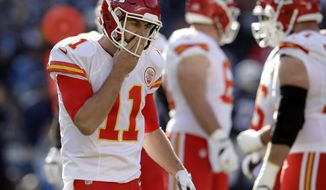 Kansas City Chiefs quarterback Alex Smith reacts during the first half of an NFL football game against the San Diego Chargers, Sunday, Jan. 1, 2017, in San Diego. (AP Photo/Rick Scuteri)