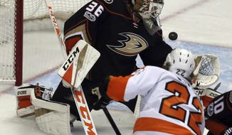 Anaheim Ducks goalie John Gibson (36) deflects the puck as Philadelphia Flyers right winger Dale Weise (22) attacks during the first period of an NHL hockey game in Anaheim, Calif., Sunday, Jan. 1, 2017. (AP Photo/Reed Saxon)